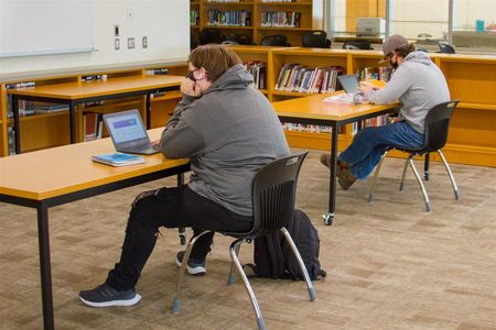 Working from the high school's library, students have access to high-speed internet and help from staff members, if needed.
